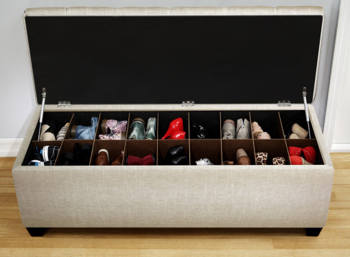 shoe bench filled with shoes