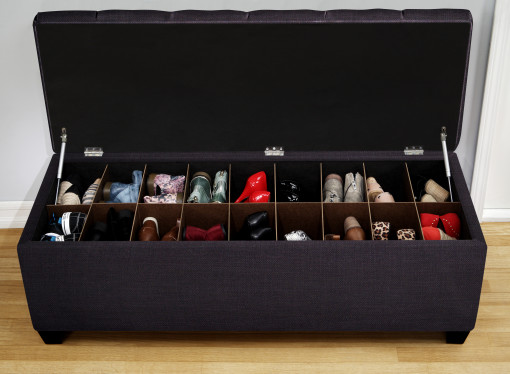 shoe storage bench with slots full of shoes